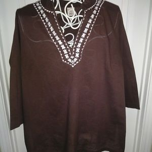Brown tunic with white detailing